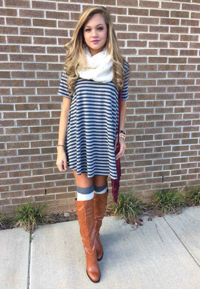 comfy outfits, striped black and white t-shirt dress, worn by a slim, young blonde girl, with tall brown leather boots, and white and grey over-the-knee socks