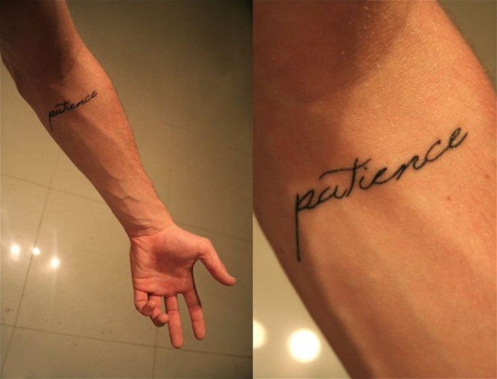 patience written in a black, fancy cursive font, tattooed on the inner part of a man's arm, below his elbow, forearm tattoos to inspire you