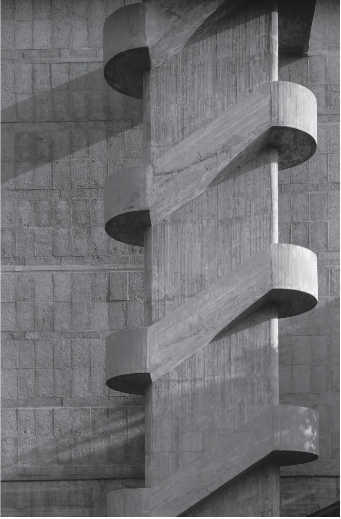 symmetrical concrete staircase, in front of a wall, covered in concrete tiles, brutalist architecture, black and white art photography