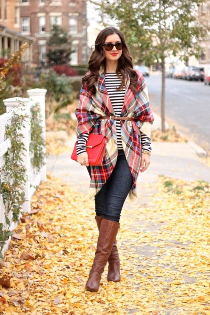 cardigan made from a plaid blanket scarf, tied with a thin, brown leather belt, worn over a striped, black and white top, and dark blue skinny jeans, tall brown leather boots, and a red clutch bag