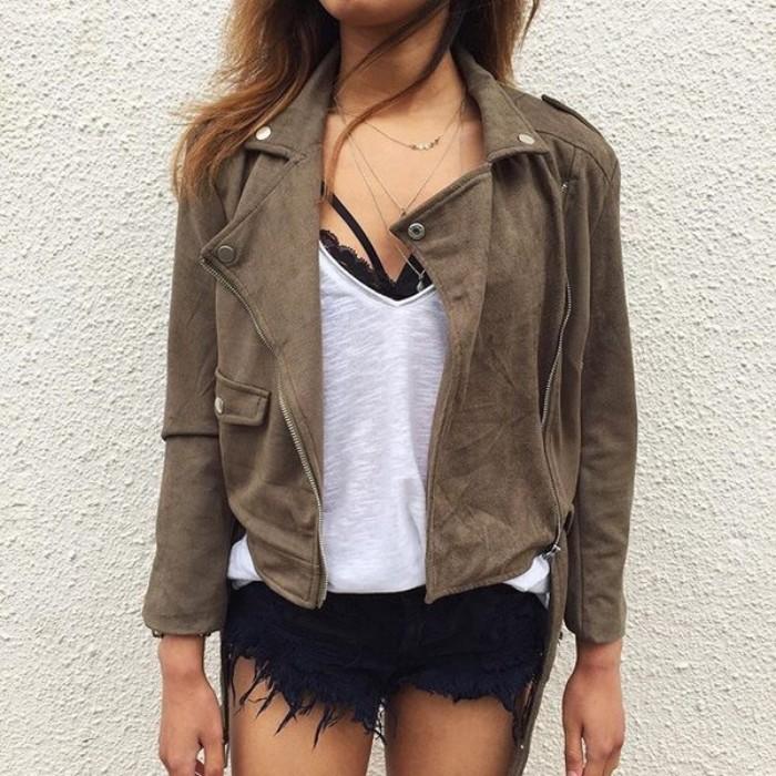 mink brown suede, biker leather jacket, worn over a loose, white v-neck top, a black bralette, and black denim cutoff shorts, what is a bralette