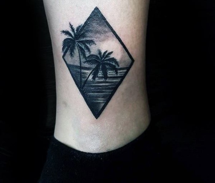 couple of palm trees, and a sunset over a sea, tattooed in a diamond shape, small tattoos for men, on a guy's ankle