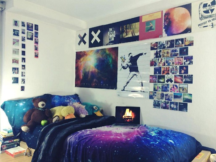 white walls decorated with multiple polaroid photos, posters and other images, teenage bedroom ideas for small rooms, near a single bed, featuring duvet and pillow covers, with outer space motifs