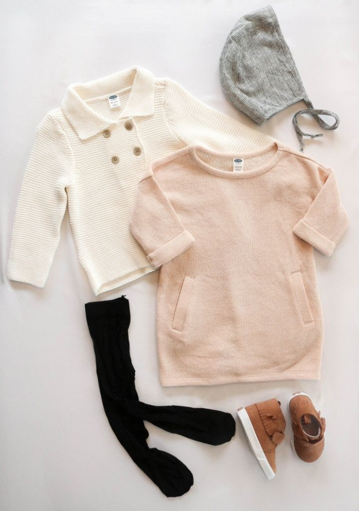 combination for girls thanksgiving outfit, pale pink jumper dress, light cream cardigan, black opaque tights, brown shoes and a light grey hat