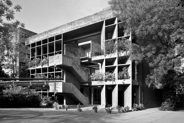 the mill owners' association building, in ahmedabad india, made of concrete, and featuring multiple windows