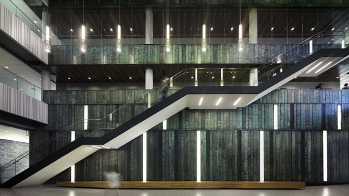 interior of the university of toronto's entry hall, brutalist art and architecture, big open plan space, with a large staircase, and multiple light sources