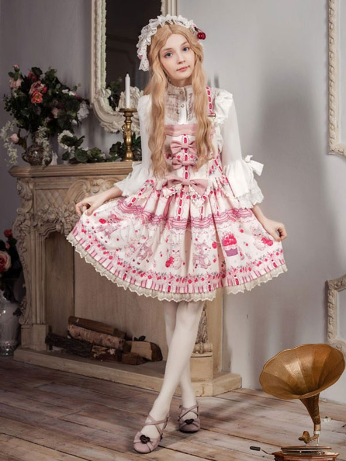 several bows and a pink pattern, decorating a white frilly sweet lolita dress, worn by a slim girl, in a long strawberry blonde wig