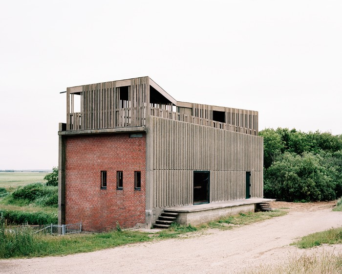 johansen skovsted design, brutalist art, of a skjern river pump station, made from brick and concrete, with a rooftop terrace