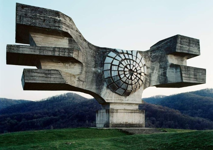 podgaric monument made of concrete, comemorating the victims of ww II, asymmetric brutalist design resembling wings