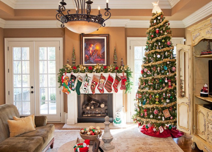 nine multicolored stockings, hanging on a white mantelpiece, decorated with a green garland, featuring gold and red ornaments, fireplace decor, a tall christmas tree, lavishly adorned standing nearby