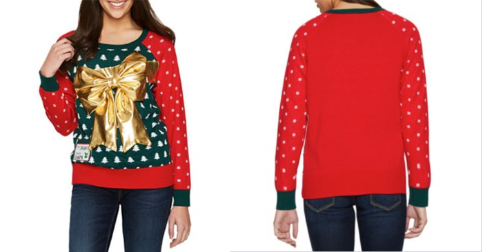 tacky jumper in dark green and red, with tiny white snowflakes and christmas trees pattern, and a large metallic gold bow, girls ugly christmas sweater