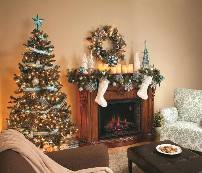 traditional living room, with a wooden mantelpiece, decorated with stockings, and a fir garland, covered in white and blue ornaments, fireplace mantel decor, christmas tree and a wreath