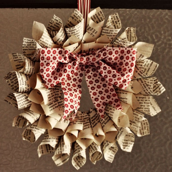 ripped book pages, folded into cones, and stuck together, in two circles, to form a christmas wreath, patterned white and red bow in the middle, holiday wreaths, easy and fast