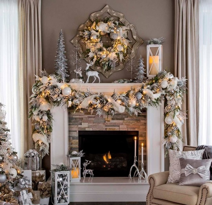 decorations in silver and white, and string lights with a yellow glow, on a mantelpiece, holiday images, inside a room with beige walls