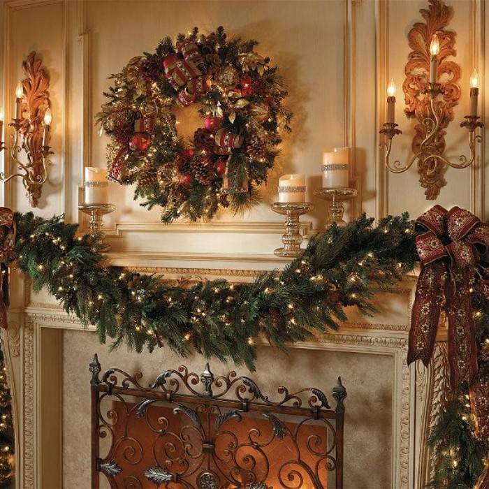 classic christmas decorations, a pine garland, covered in small, glowing fairy lights, and a wreath with pine cones, red baubles and fairy lights, near a fireplace, with a beautiful wrought iron grate