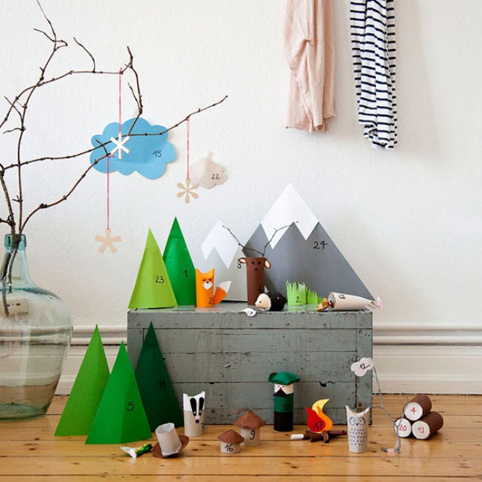 mountains and trees, and woodland animals, made from colorful paper, each paper shape has a small number, from 1 to 24