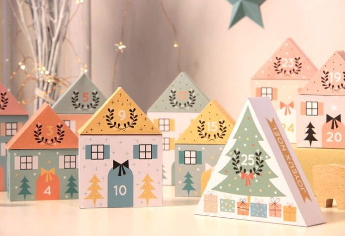yellow and coral pink, light teal and white, miniature houses made of card, each is numbered, and decorated with christmas motifs, christmas countdown calendar, colorful idea for kids