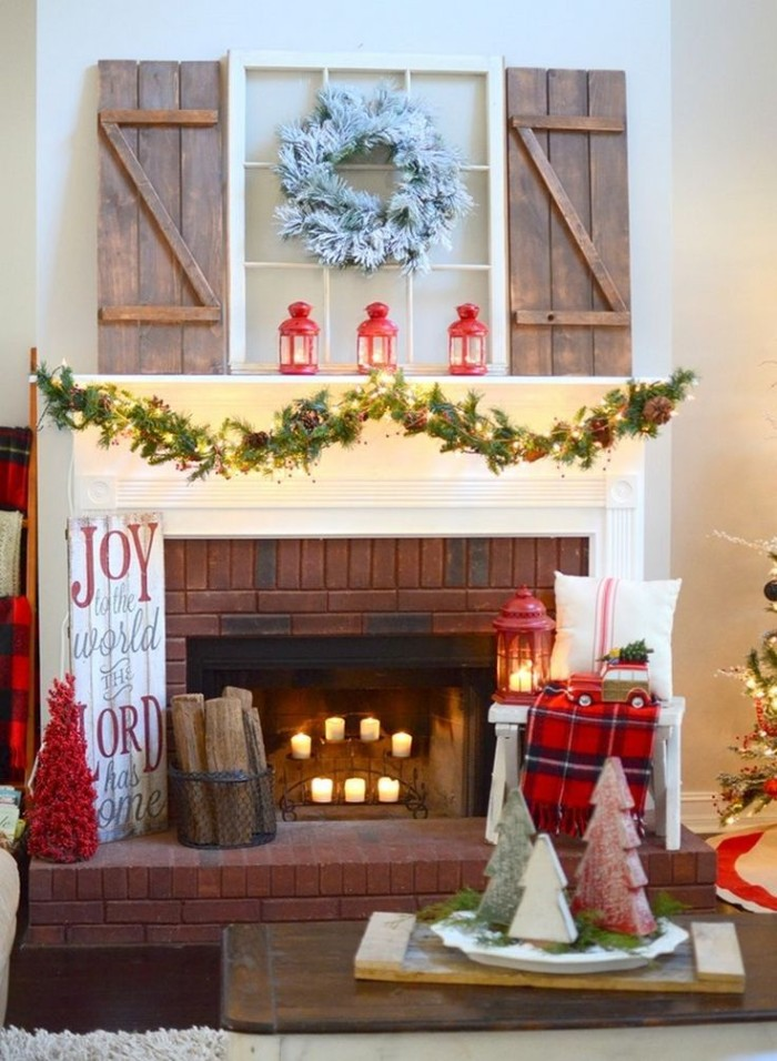 diy fireplace mantel decor, featuring a faux window, with wooden blinds, a white wreath, and a garland with fairy lights