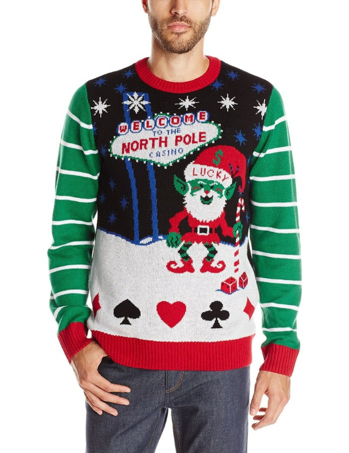 playing card synbols, and an elf dressed in a red suit, on a jumper inspired by las vegas, worn by a slim man, ugly sweater party, welcome to the north pole casino, written in red and blue