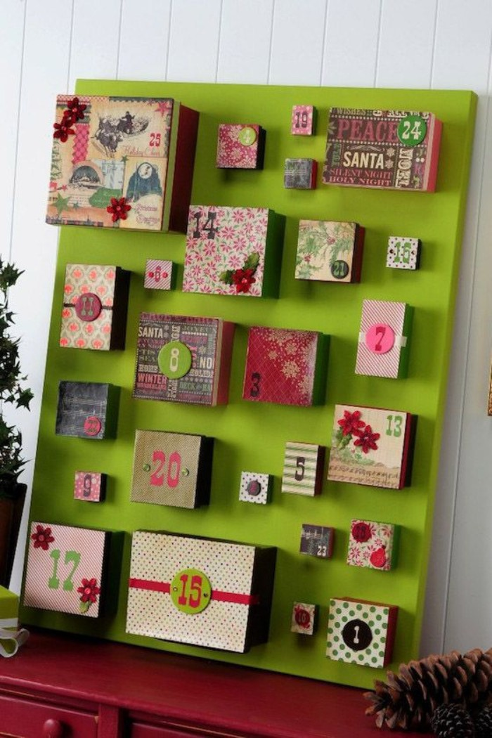 acid green board, featuring numbered colorful, advent calendar boxes, in different shapes and sizes, decorated with paper decoupage