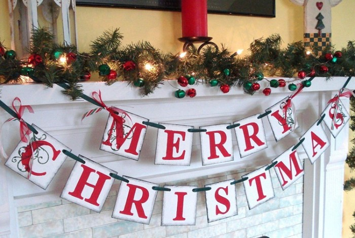 banners with the words, merry christmas written in red, hanging from a white mantelpiece, images of christmas, pine garland and glowing fairy lights