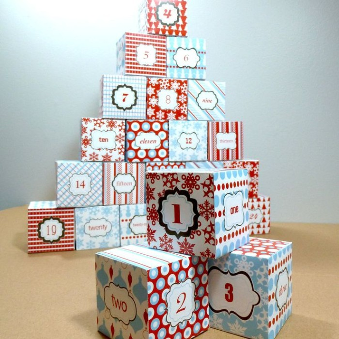 cube-shaped numbered small boxes, made from patterned card, in light blue and red, white and black, fun advent calendars