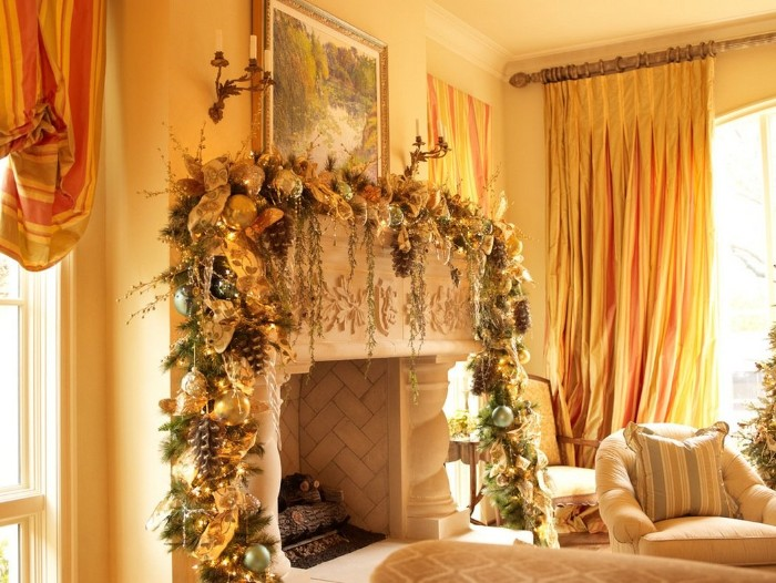 well lit rooom, with orange curtains, and a classic fireplace, decorated with a large garland, in green and gold, with baubles and pine cones, christmas fireplace ideas