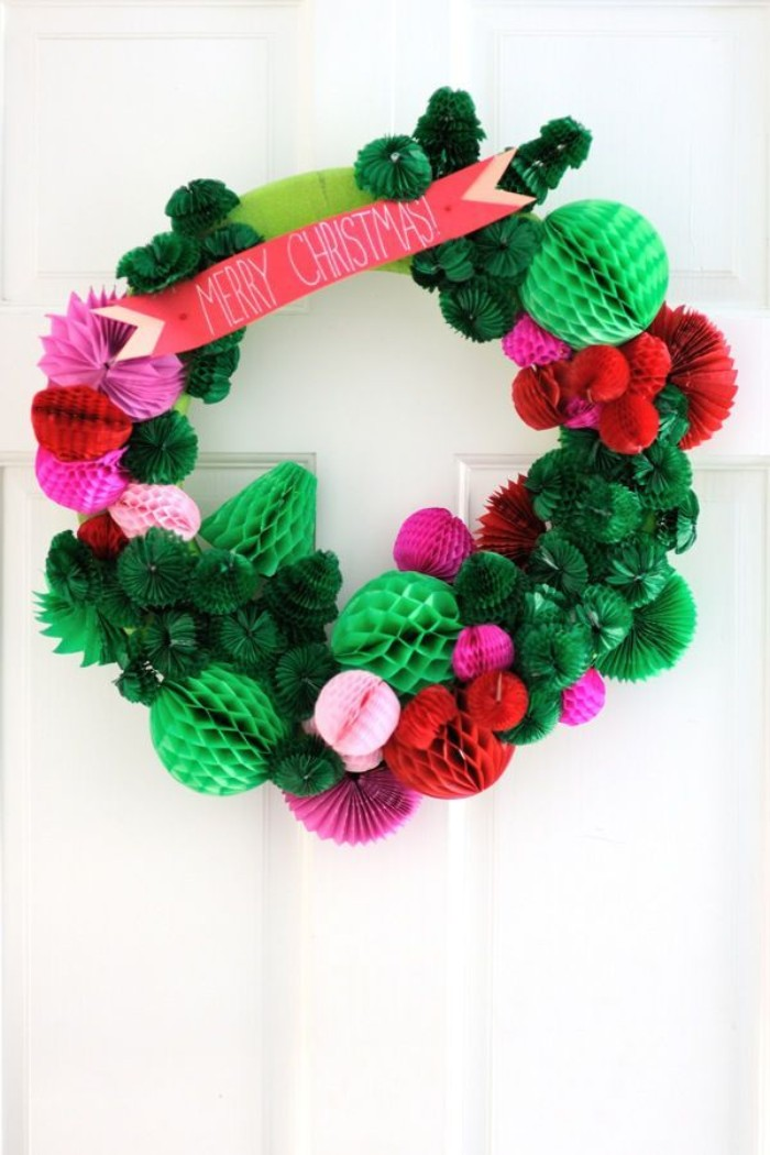 christmas wreath ideas, multiple paper shapes, in light and dark green, pink and red, stuck together to form a wreath, with a coral pink banner, reading merry christmas