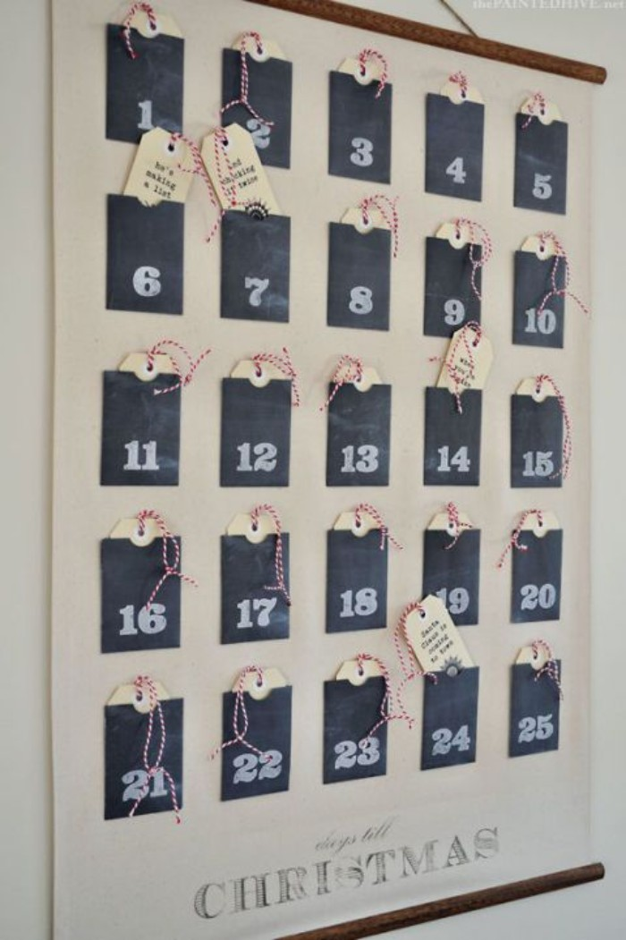 25 black pockets, attached to a white poster, each posket has a number, written in white chalk, and contains a small tag, with a short text, printed in black