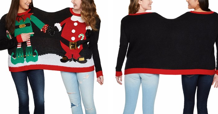 buddy jumper shared by two laughing girls, ugliest christmas sweater, in black with red trims, featuring an elf and a santa