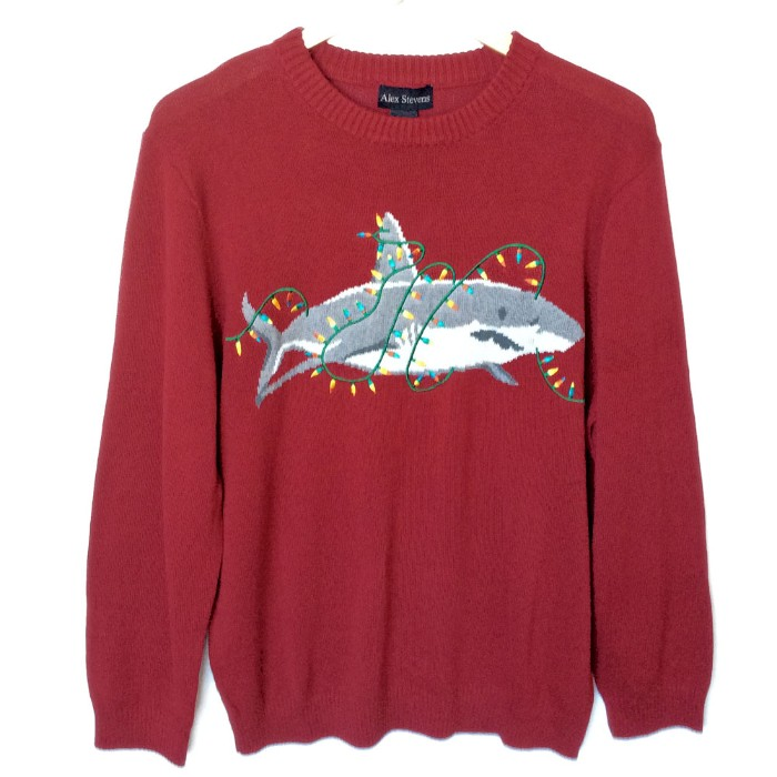 string lights in different colors, wrapped around a grey and white shark, image on a dark red xmas jumper
