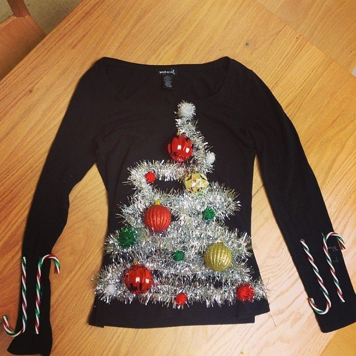 plain black fine knit jumper, decorated with silver garlands, shaped like an xmas tree, with red and green, and gold baubles, diy ugly christmas sweater, two candy canes on each sleeve