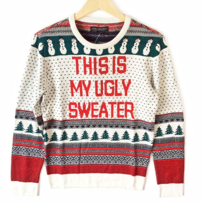 white knitted jumper, with red and green, grey and black motifs, featuring snowmen and christmas trees, ugly christmas sweater ideas