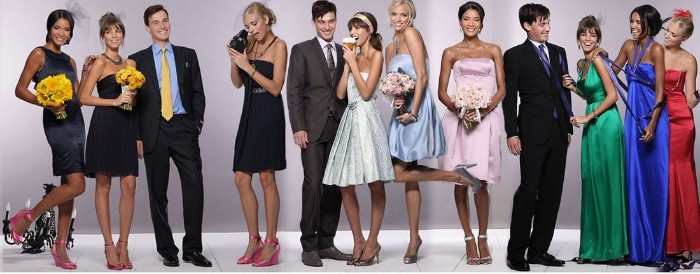 nine women dressed in different fancy dresses long silky gowns, little black dresses, midi dresses in silver, and pastel colors, cocktail attire for women, three men in dark colored suits