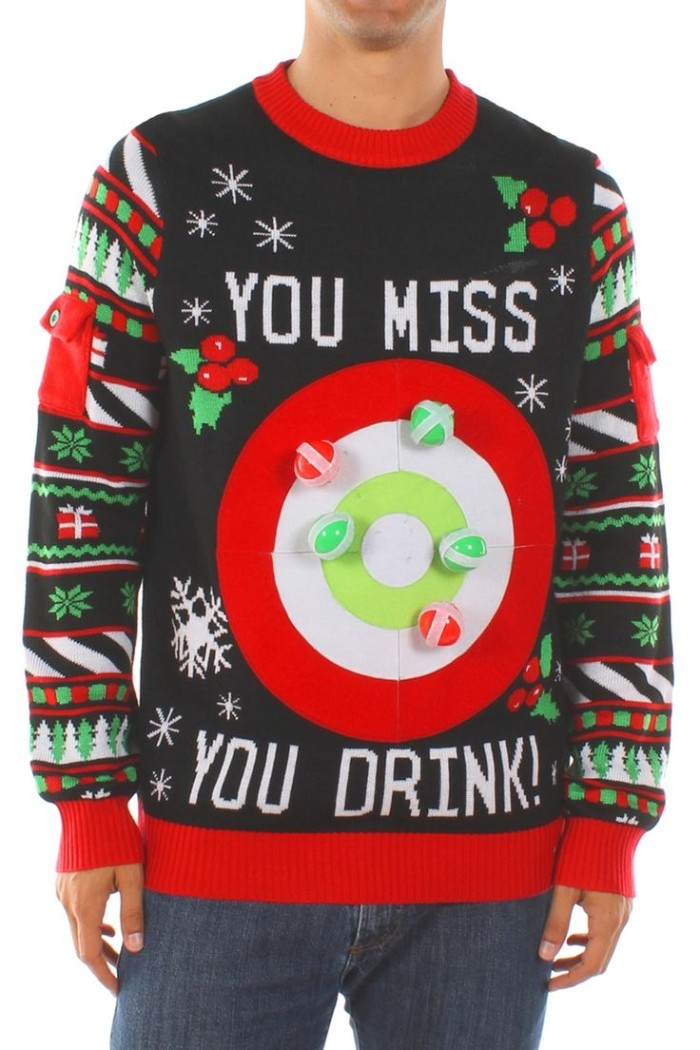 close up of a black jumper with red, green and white motifs, featuring snowflakes and presents, holly branches and xmas trees, and a large target, with the words you miss you drink