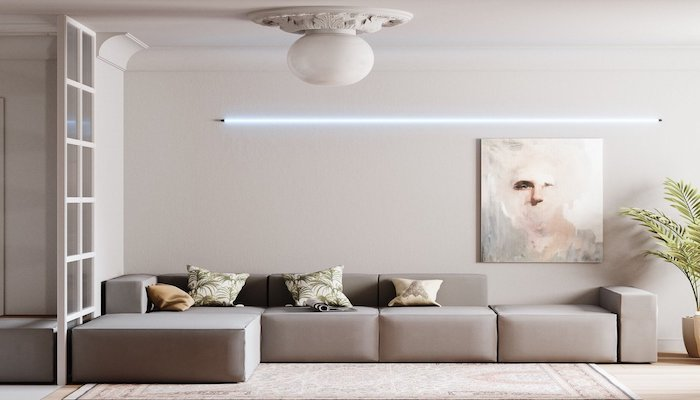 beige walls, large beige corner sofa with printed throw pillows, minimalist painting, led light, wooden floor with printed carpet, living room ideas pinterest