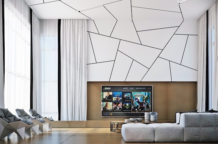 white geometrical wall and ceiling installation, grey corner couch, grey leather armchairs, accent wall ideas