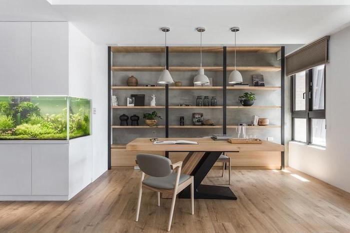 large fish aquarium, wooden desk and bookshelves, work office decorating ideas, two small grey chairs