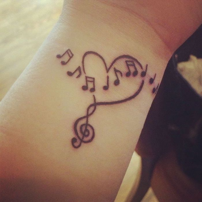 music notes in the shape of a heart, cute tattoos for girls, tattoo on the wrist