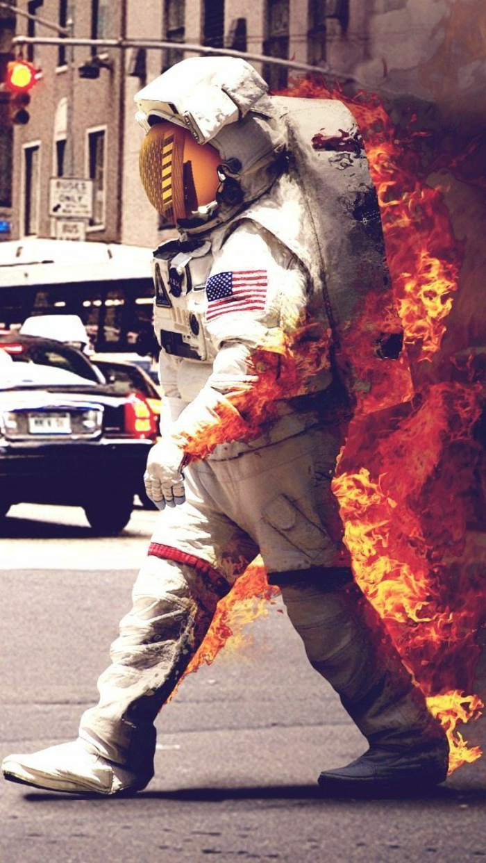 astronaut on fire, cute iphone wallpapers, walking down the street, cars and traffic light in the background