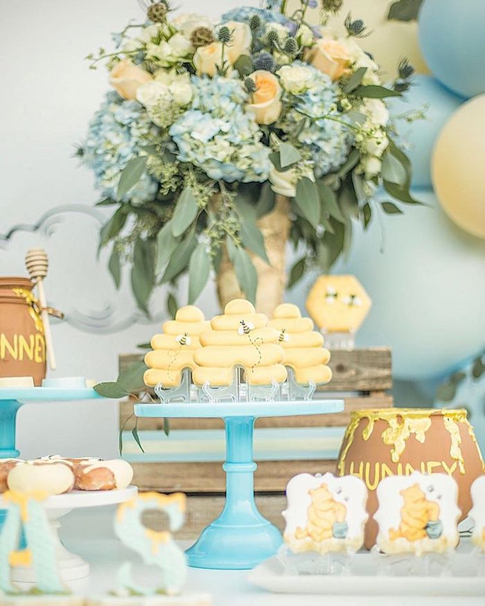 blue and yellow flower bouquets, honey pots and cookies, baby shower party ideas, blue cake stand