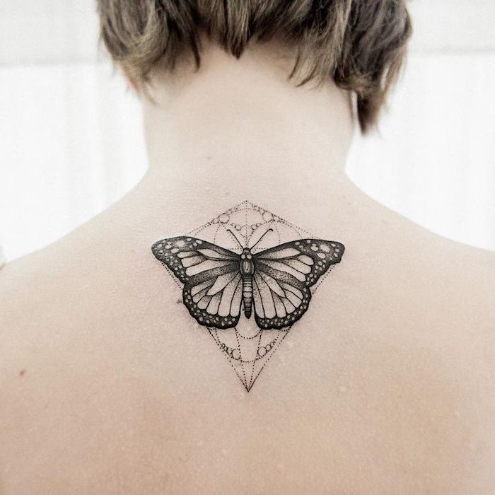 butterfly tattoo on the back, white background, tattoo ideas for women, short dark blonde hair