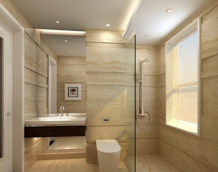 beige sand tiled walls and floor, bathroom remodel ideas, large mirror, floating wooden shelf and sink