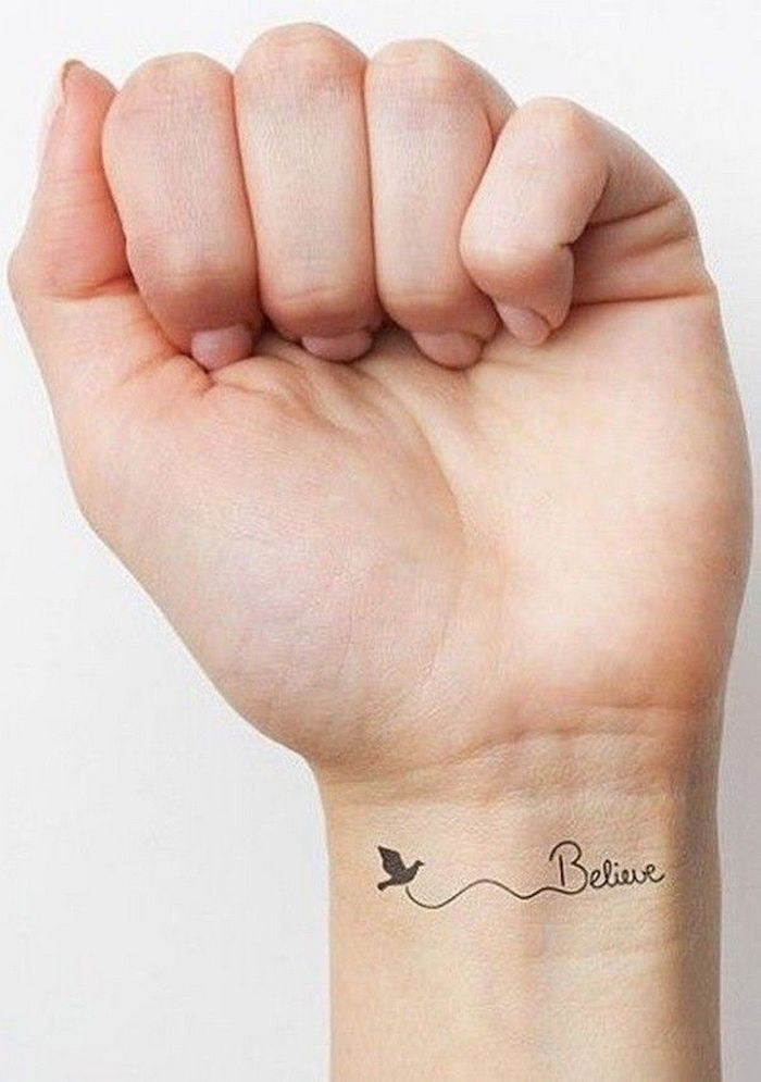 believe inscription, tattoo on the wrist, tattoo designs for women, nude nail polish, white background