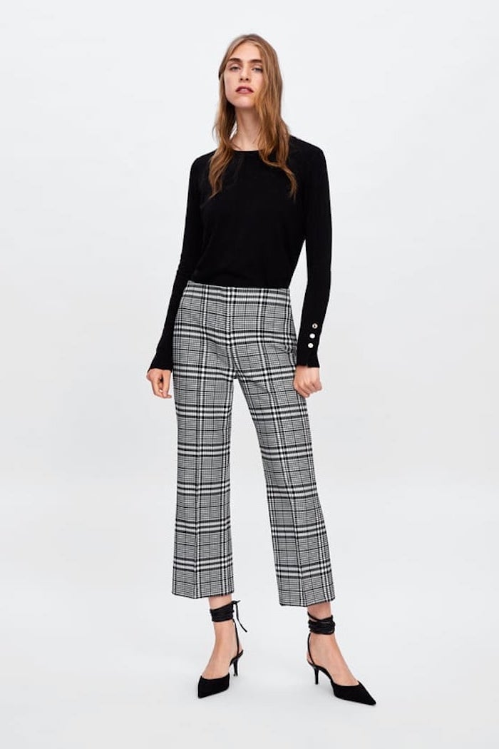 grey and white stripe trousers, black pointed shoes, women's professional clothing, black blouse