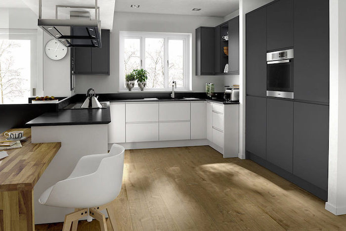black cabinets and counters, white cabinets and drawers, beautiful kitchens, wooden floor