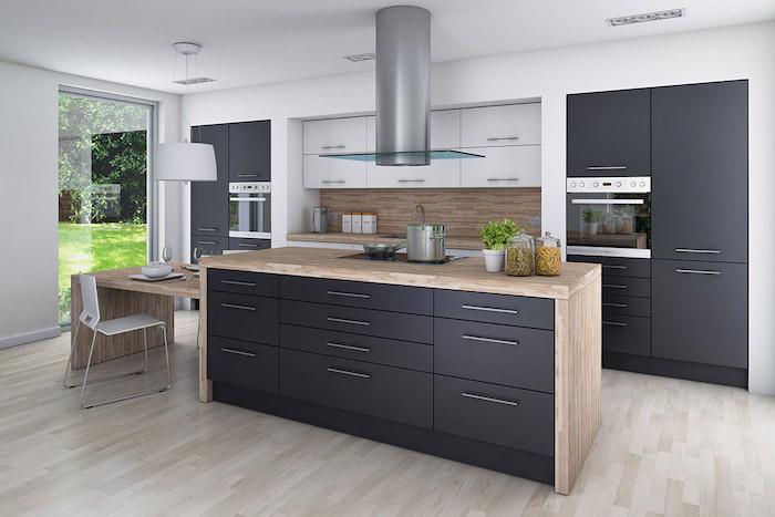 black cabinets and drawers, beautiful kitchens, wooden kitchen island, tiled backsplash, beautiful kitchens
