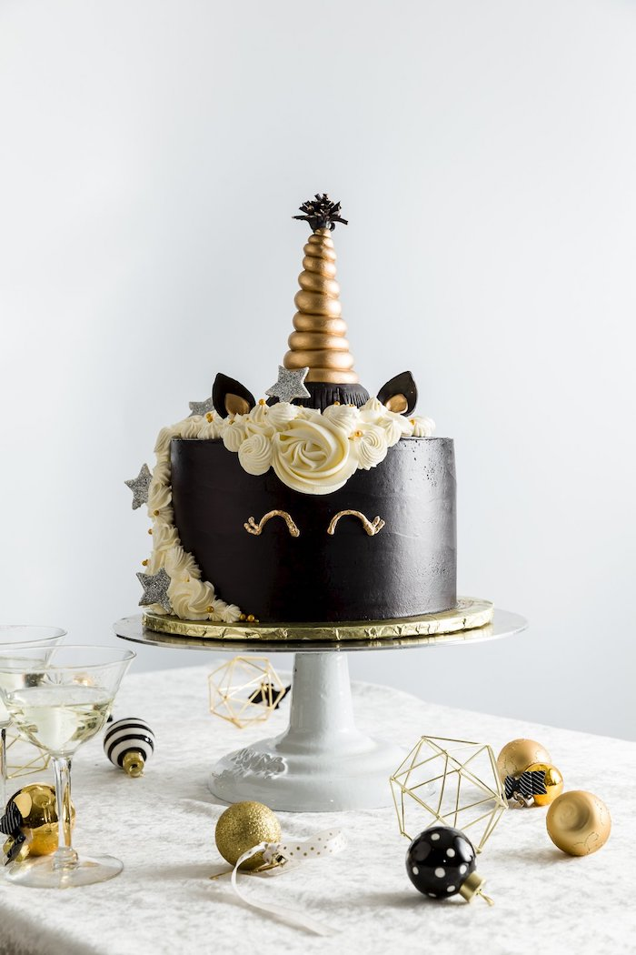 how to make a unicorn cake, white roses on white fondant, gold horn, gold and white cake stand