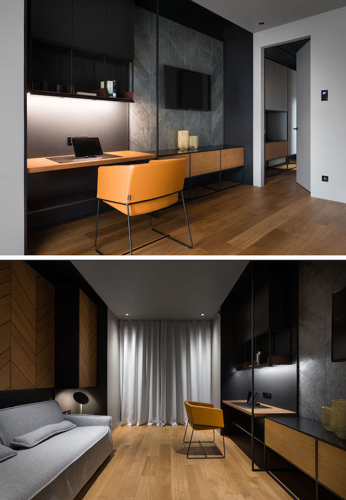 black and grey wall, black bookshelves, wooden desk, brown leather chair, office design