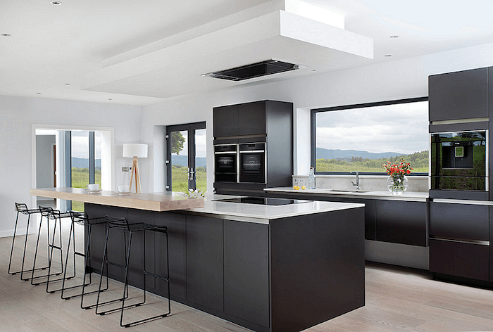 black kitchen island, metal black stools, kitchen decor ideas, black cabinets, white counters